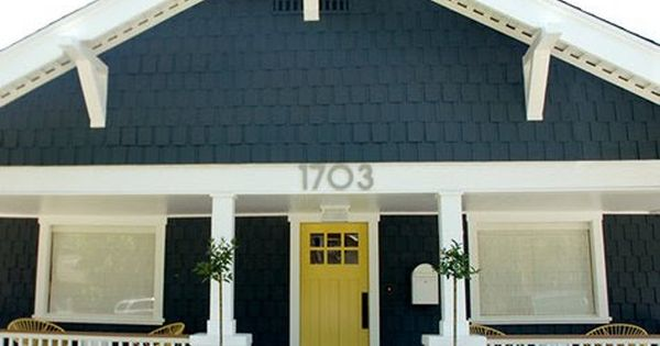 yellow front door. teal gray shingles. white trim. love the color combo