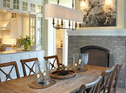 Welcoming Intimate Showhouse Kitchen: Welcoming Dining Room With See Through Fireplace Into