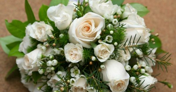White Baby Roses and Roses from Spring in the Air mixed with a simple touch of foliages and wax flower can make a truly sophisticated bridal bouquet.