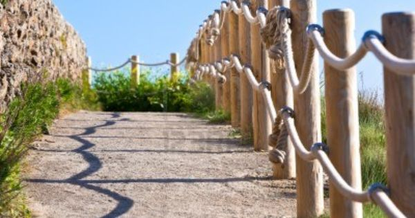 Pathway With Wood Post And Thick Rope Fence Yard And