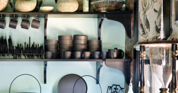 Open shelves -- nice. Atlanta home... the black and aqua color scheme