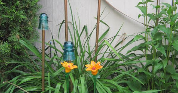 Old electric glass insulators on copper pipes become for Dishfunctional designs garden