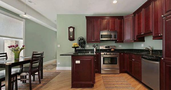 hardwood flooring in the kitchen the cherry cabinet color with the light walls home 7010