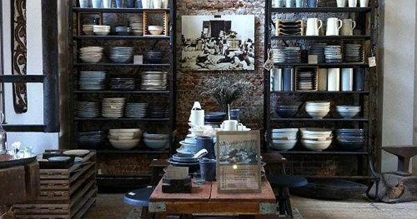 brick wall and simple kitchen shelves and wooden dining table