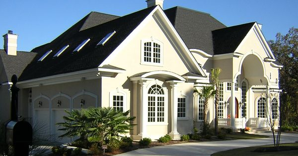 Front View Of Stuccoed Lake Home Custom House Designs By