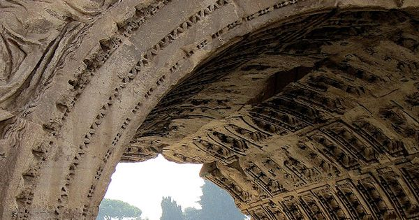 """The ruins of the """"Old City"""" in Rome through the Arch of"""