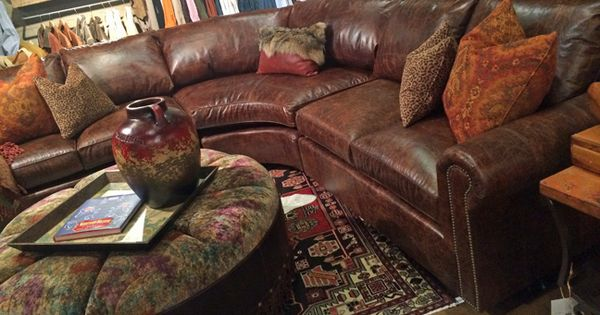 Brown distressed leather sectional sofa and round tufted ottoman with leather fringe. http://www ...