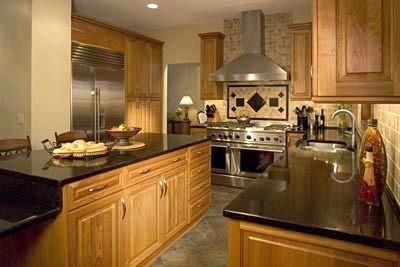 Backsplash With Dark Countertops Black Granite Countertops And Maple Cabinets And Entert Trendy Kitchen Tile Kitchen Tiles Design Transitional Kitchen Design