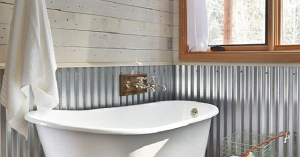 Corrugated metal wall at chair rail height in bath