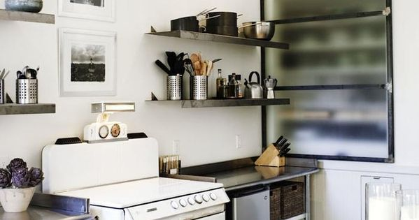 vintage stove. stainless steel kitchen, rug in the kitchen. Reminds me of