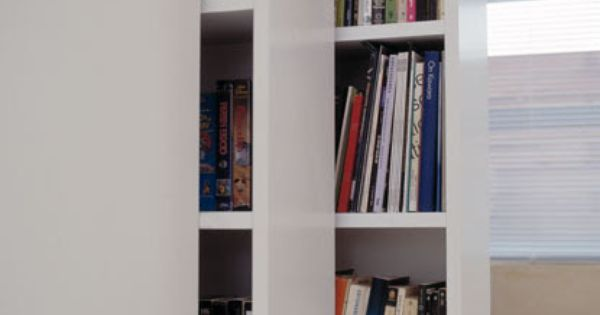 Retractable bookshelves inside claudio silvestrin 39 s home for Minimalist house essentials