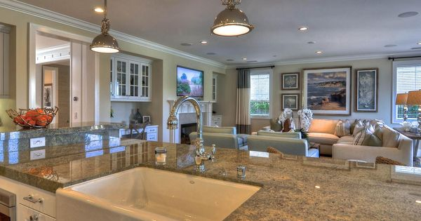a large granite topped kitchen island adds plenty of