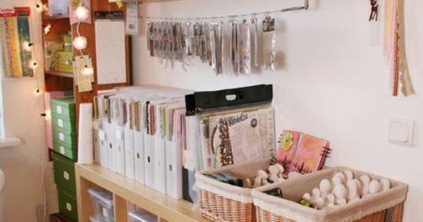 craft supplies organization with plastic bins in Ikea shelving