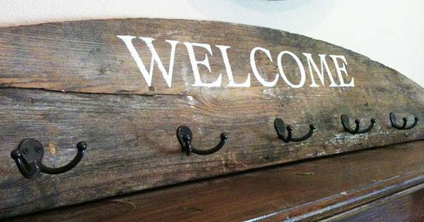 Repurposed & Upcycled: reclaimed wood coat hanger sign. Could add embellishments for