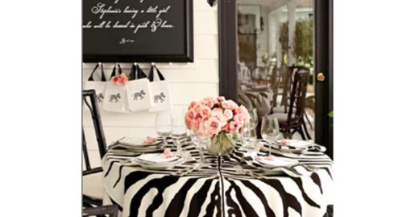 Gorgeous baby shower decor featuring zebra print and pastel pink for a