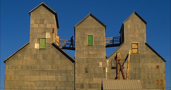 An elevator worker traverses a trio of high towers in leola sd south dakota pinterest - Modern architectural trio ...