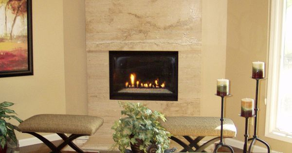 Floor to ceiling travertine fireplace that creates a for Focal point flooring