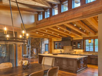 Exposed Heavy Timber Beams With Wood Ceiling At High And