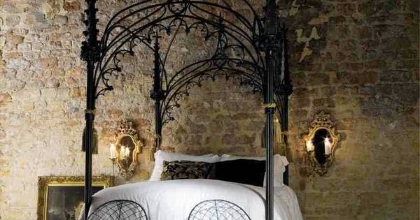 Elaborate Wrought Iron Makes This Canopy Bed Dark And A