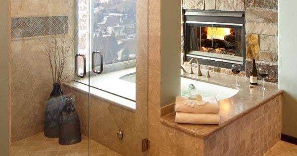 Shower and bath tub with fireplace and a view. Yes please! Dream