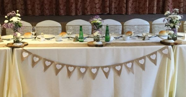 rustic wedding with a top table decorated with ivory table
