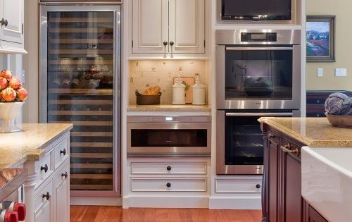 Love the wall ovens. Double oven, microwave drawer, TV and wine cooler.