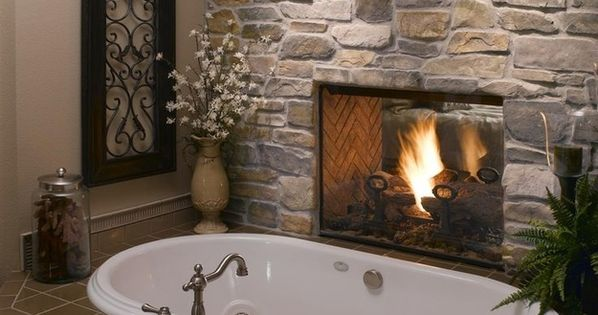Fireplace between the master bedroom and tub. With or without the fireplace