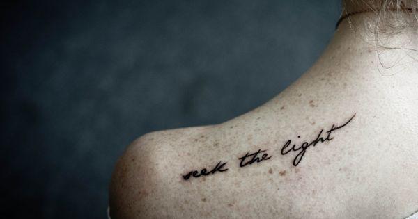 'Seek the light' back tattoo