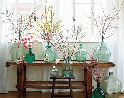 A collection of colored glass jars & beautiful, yet simple flowers to
