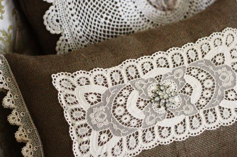 burlap pillows with vintage lace doilies!