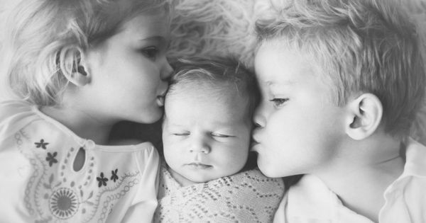 Cute newborn with siblings pictures