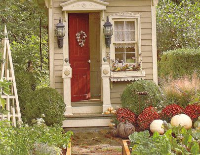 Very elegant little garden shed and raised beds. Cover photo from Country