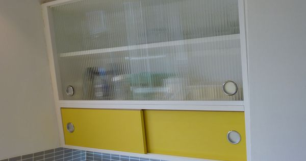 angled wall cabinet with formica and reeded glass doors custom made