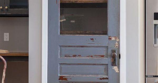 Antique door repurposed as pantry door - by Rafterhouse. would love this