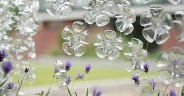 Recycled plastic bottle bottoms - turn into flowers to decorate a window