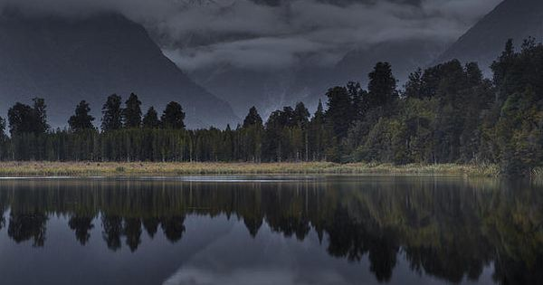 Sunset Reflection Of Lake Matheson in New Zealand, by Colin Monteath