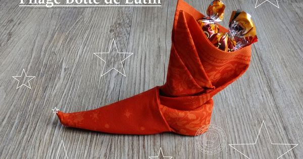 100 gourmande pliage serviette botte de lutin garnie de chocolat noel pinterest - Pliage de serviette noel botte ...