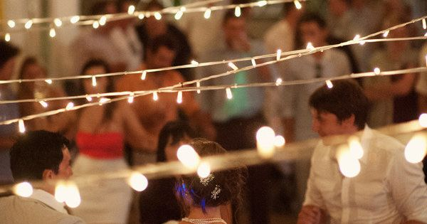 Jennifer Wedding: Skip the tent and string lights across the seating/dancing area!
