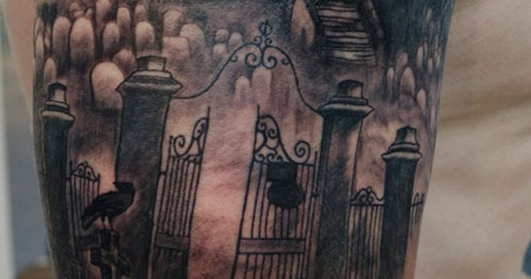 Haunted house & graveyard half sleeve tattoo by Andy Howl.