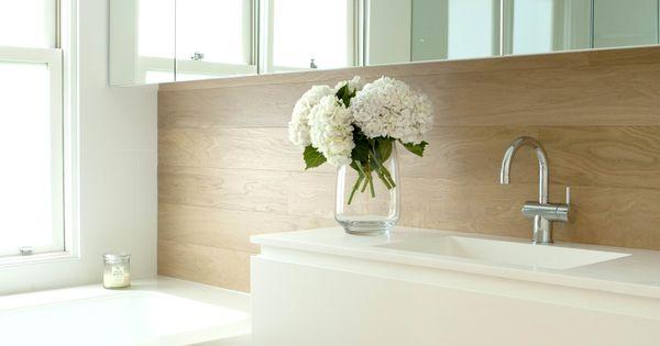 Beach house bathroom decor - Main Bathroom With Corian Clad Bath And Basin And Timber Panelling