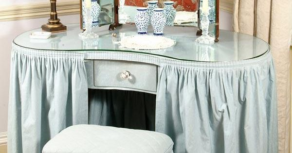 A Blue Cotton Covered Kidney Shaped Dressing Table With
