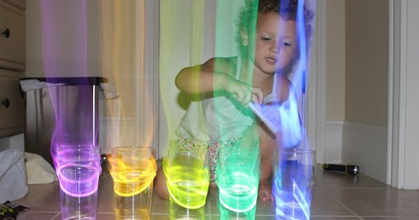 Glow stick xylophone. Put the glow sticks in cups of water and