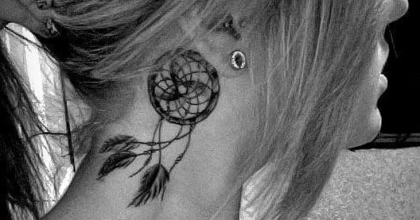 Dreamcatcher tattoo behind the ear. I don't have a strong desire to