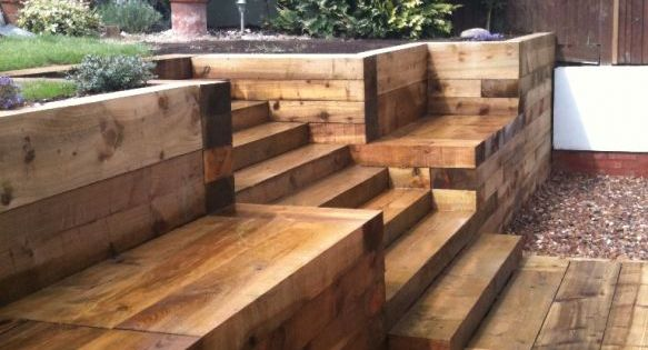 Steps, walls & Patio with new railway sleepers. Pretty good idea for