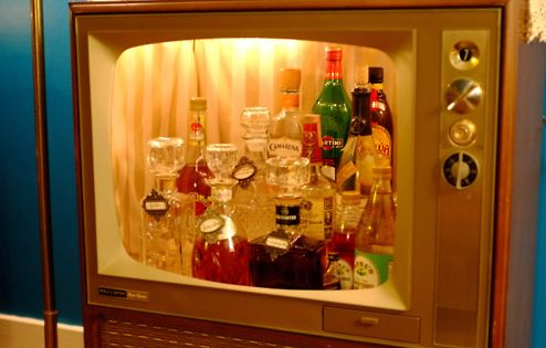 Repurposed vintage TV liquor cabinet? so very mad men...