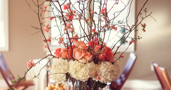 Spring centerpiece flowering quince branches white