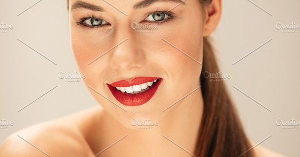 Close up portrait of caucasian female model with beautiful makeup. Young woman with perfect skin in studio.
