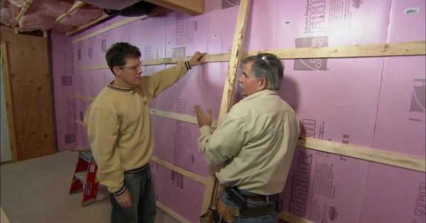 How to frame out basement walls this old house love for Does a walkout basement cost more