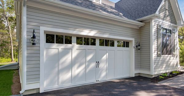 Clopay Craftsman Collection Carriage House Garage Door Design 12 With Rec13 Windows In White Www Clopaydoo Garage Door Styles Garage Doors Garage Door Design