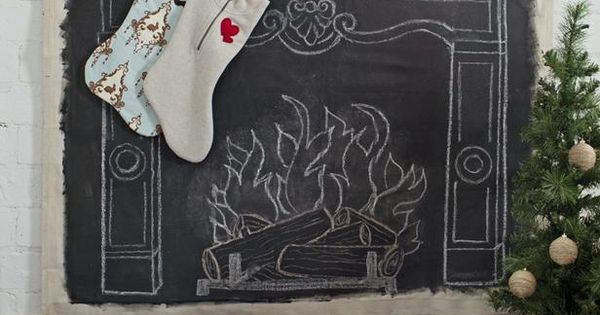 Faux fireplace and mantel on drop cloth with chalkboard paint